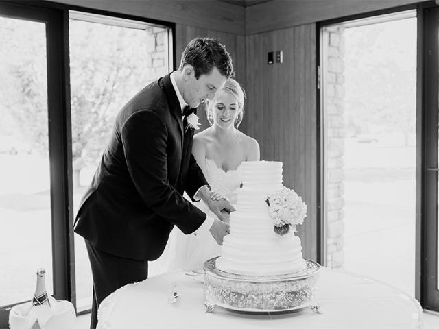 Abby & Nick Cutting Cake