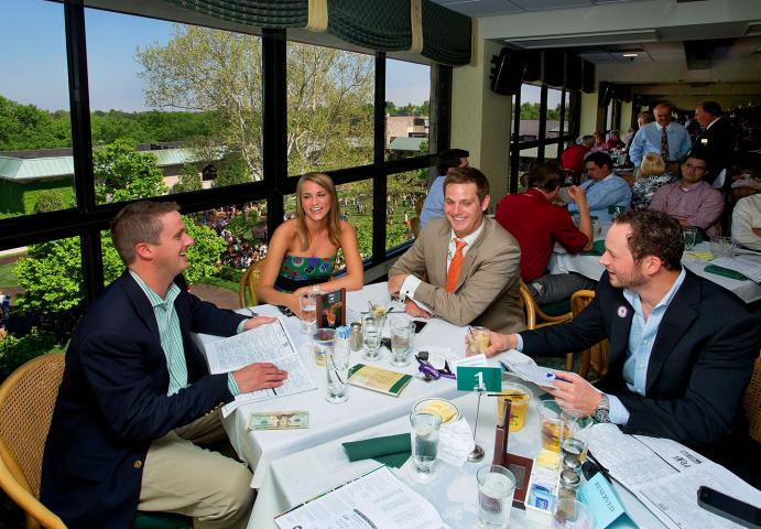 Keeneland guests dine at table