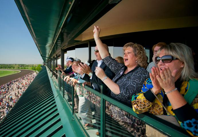 Keeneland guests enjoying race from box balcony