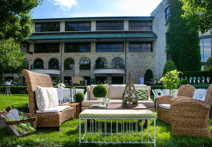 Wicker chairs and couch with table in Keeneland paddock