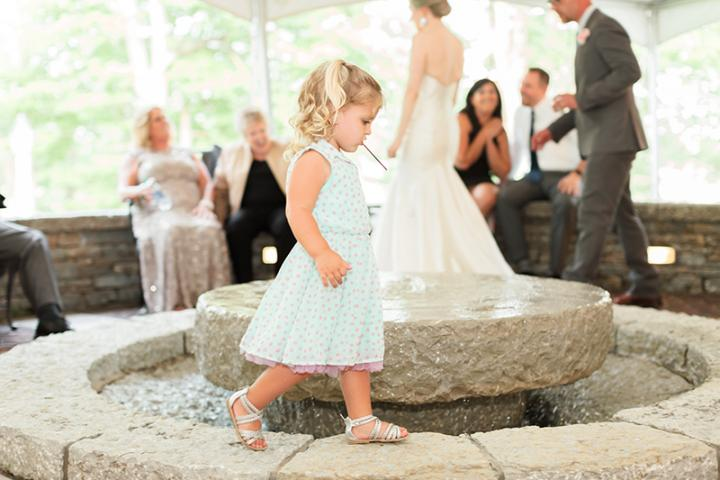 little girl walking on fountain