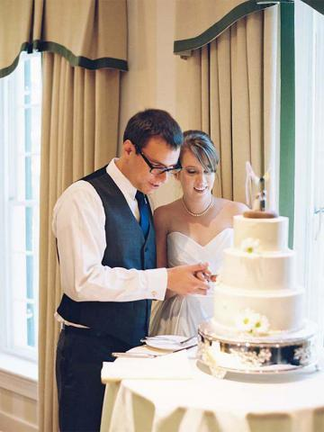 Elizabeth & Tim cutting their wedding cake